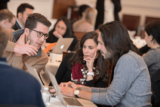 Harvard researchers discuss a marketing summary at the 2018 Bench-to-Business Boot Camp. Image credit Tony Rinaldo Photography.