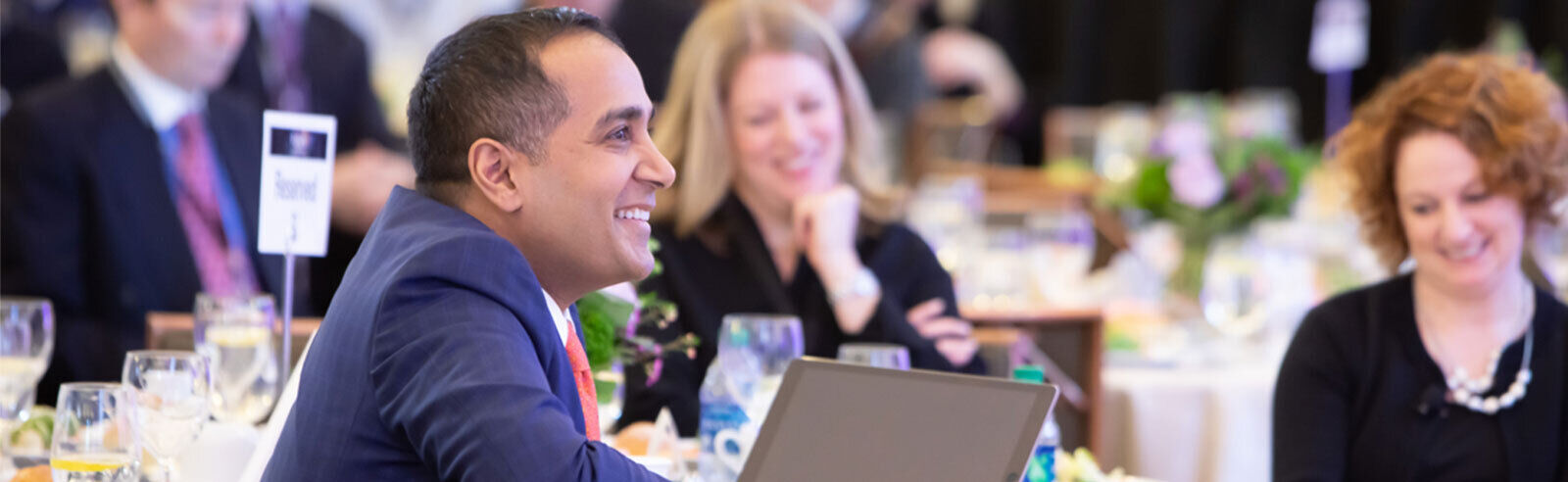 Harvard alumnus Sachin H. Jain is seated with other speakers at the 2019 Fusion symposium. Image credit Russ Campbell.