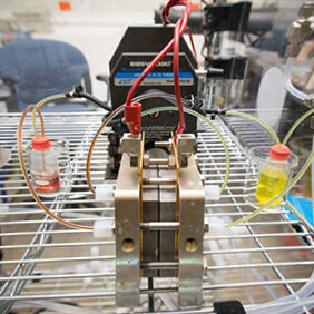 A prototype flow battery, pictured in the lab at Harvard SEAS. Image credit Eliza Grinnell.